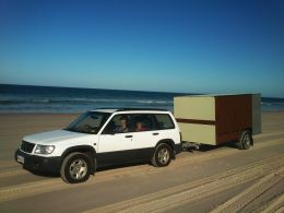 Forester and camper on beach