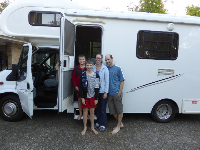 family ready to leave in front of motorhome