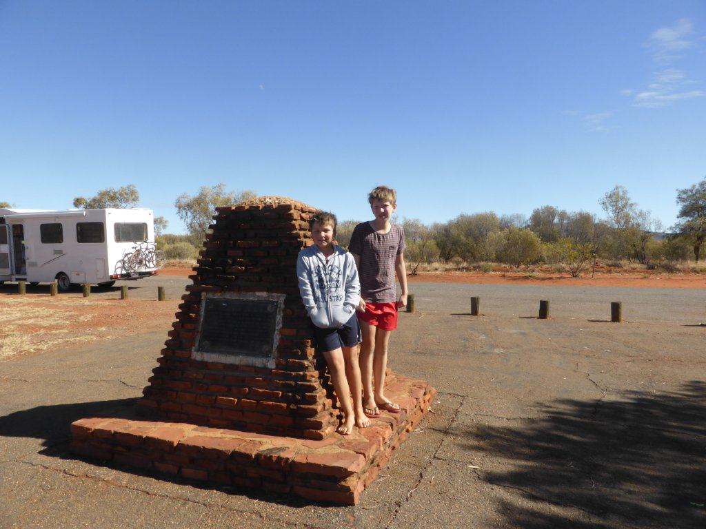 Jonathan and Daniel at the Stuart Memorial at the centre of Australia!