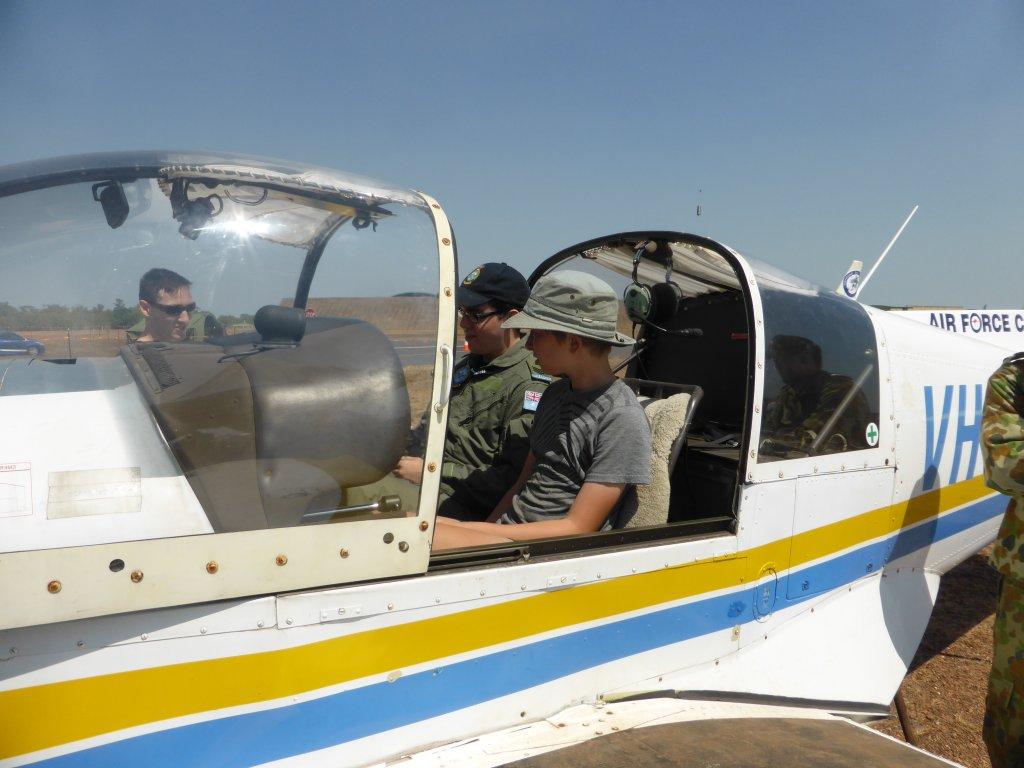 Jonathan in Airforce Cadet training plane. He'd actually be old enough to learn to fly it in a years time!