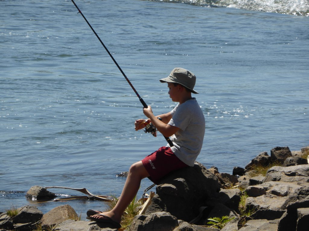 Daniel fishing in the Ord River. He is really good at loosing/snagging lures...