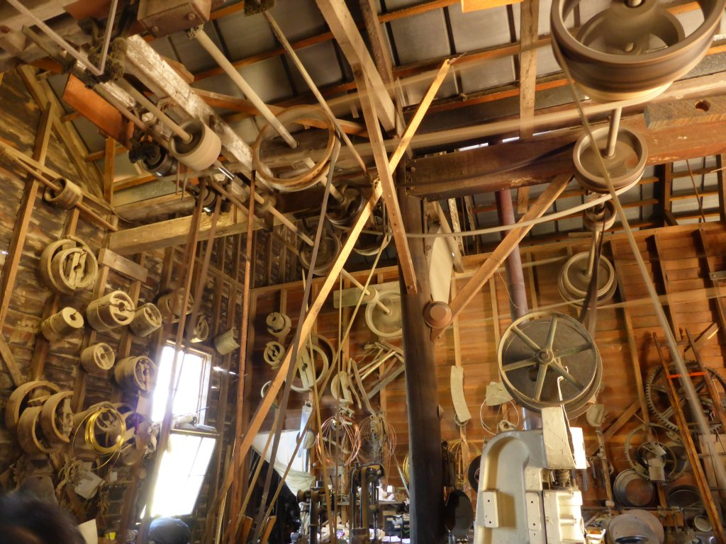 check out the pulley and leather belts in this shop! all steam driven....
