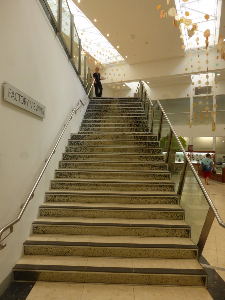 the coin staircase. Is that a Christmas tree they form?