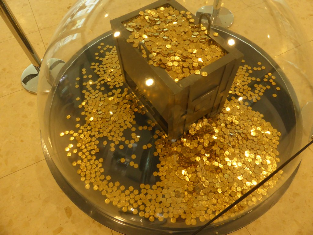 In the foyer, qty 10,000  one dollar coins! Nice and shiny when new!