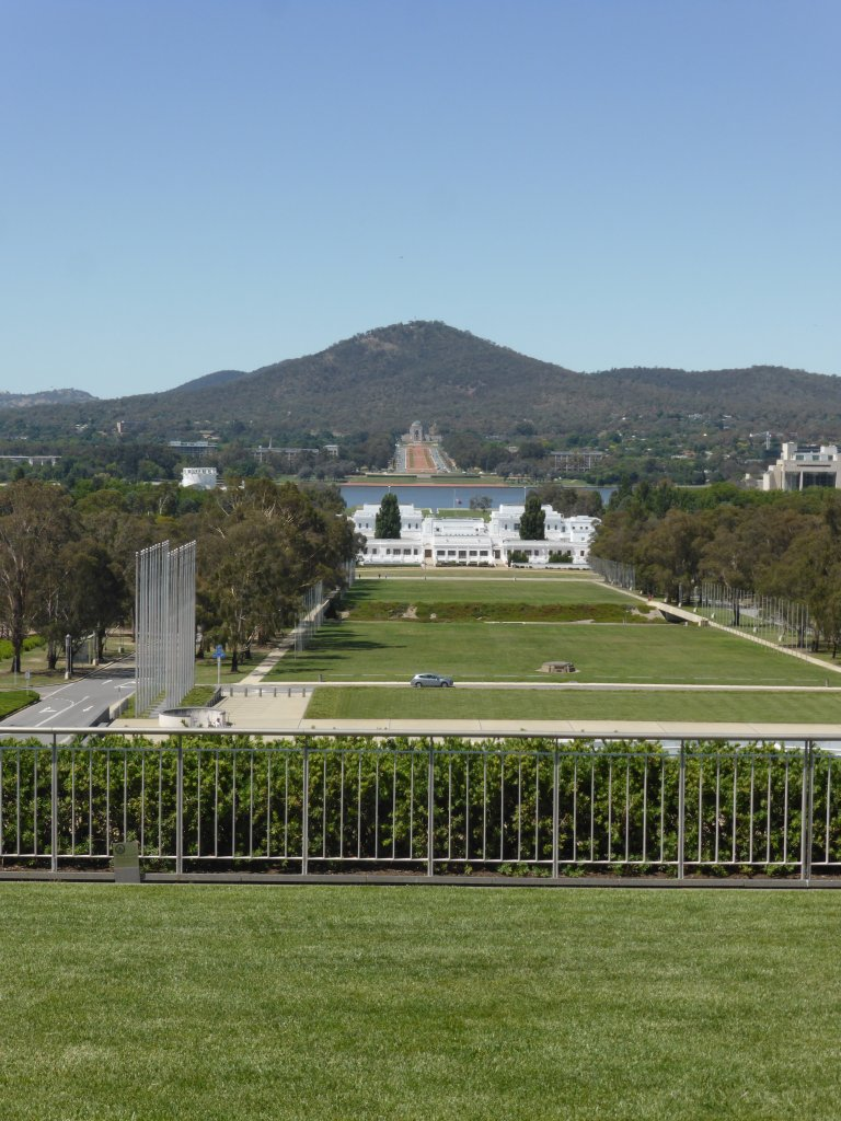 on the roof of Parliament House. Looking over old parliament house up to the War Memorial. This line was the first one drawn on the map by the architect designing Canberra.